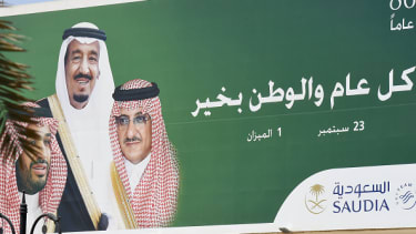 A poster featuring King Salman, former Crown Prince Mohammed bin Nayef, and new Crown Prince Mohammed bin Salman.
