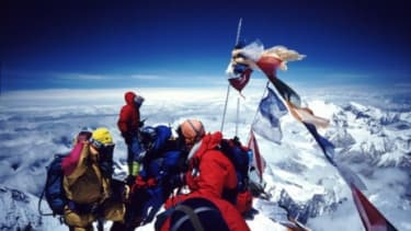 A group of climbers on Mount Everest's summit: Thousands of people have made it to the top of the world's tallest mountain, but hundreds have died trying.