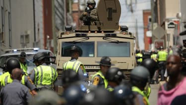 A Virginia State Police officer in riot gear keeps watch from the top of an armored vehicle in Charlottesville, Virginia.