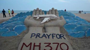 A sand sculpture honoring Flight 370.