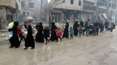 Syrian residents, fleeing violence.