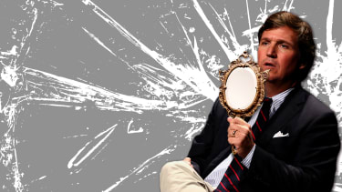 Tucker Carlson holding a mirror facing away from him.
