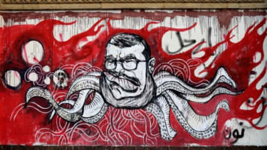 Graffiti depicting Mohamed Morsi covers an outer wall of the presidential palace in Cairo, Egypt.