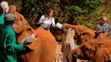 Melania Trump feeds an orphaned elephant at the David Sheldrick Wildlife Trust in Kenya