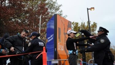 Runners file through a security checkpoint before the start of the ING New York City Marathon on November 3 in Brooklyn.