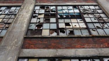 Broken windows in a factory.