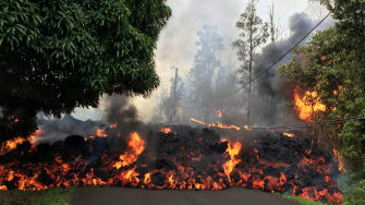 Lava flows across a road in Hawaii