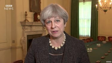 British Prime Minister Theresa May says she'll warn Trump about leaks