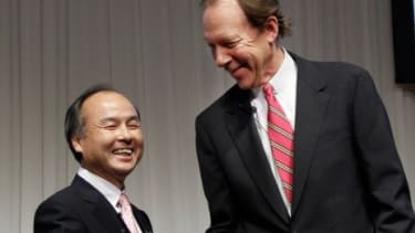 Softbank CEO, Masayoshi Son (left) and Chief Executive of Sprint Nextel Corp., Dan Hesse shake hands during their press conference in Tokyo, on Oct. 15.