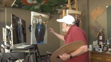 John Deckert working on a painting.