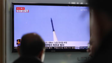 A TV displays a North Korean missile launch