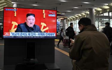 Kim Jong Un appears on a news broadcast.