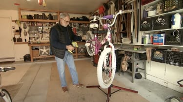 Ric Jackson fixes a bike.
