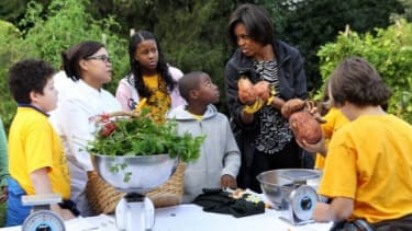 Michelle Obama and local D.C. fifth graders harvest the White House's vegetable garden including sweet potatoes weighing up to four pounds.