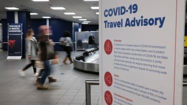 Signs warn travelers of Covid-19 in New York's LaGuardia Airport