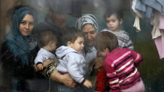 Syrian refugees wait in a camp