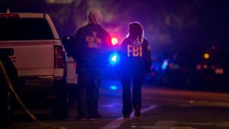 F.B.I. agents monitor the scene near mass shooting.