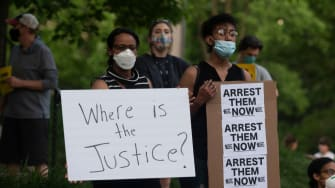 A group of protesters gather outside the home of Hennepin County Attorney Mike Freeman on May 28, 2020