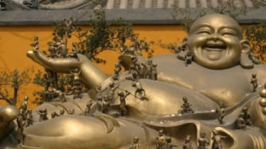 Could the fat Buddha be an influence on other religions? Churchgoers are more likely to become obese than those who avoided it, according to a new study.