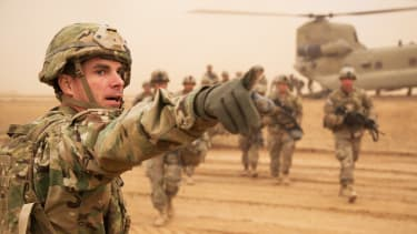 U.S. Army Cpt. Andrew Roberts directs newly arrived paratroopers where to go near Mosul, Iraq, Feb. 5, 2017.