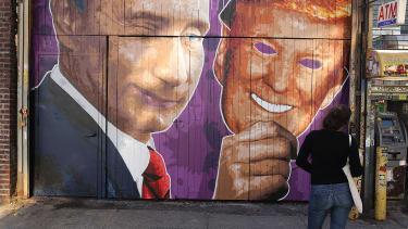 A mural depicting a winking Vladimir Putin taking off his Donald Trump mask in Brooklyn.