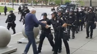 This June 4, 2020, file image from video provided by WBFO, a Buffalo police officer appears to shove a man who walked up to police in Buffalo, N.Y.