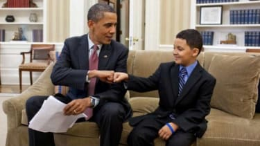 President Obama helps a little man out