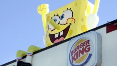 SpongeBob SquarePants sits on top of a Burger King restaurant: The fast food chain is one of 19 adding healthier options to their kids' meal menus.