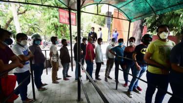 Coronavirus testing line in India.