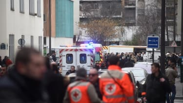 Attack on satirical Paris newspaper leaves at least 12 dead