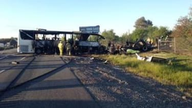High school tour bus hit by a truck in California, 9 killed