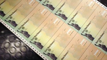 Blank Social Security checks are run through a printer.
