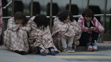Owners of sunken South Korean ferry linked to mass cult suicide