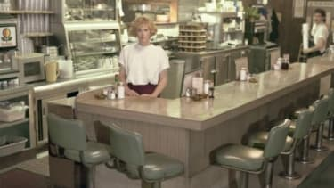 A waitress works the nightshift at a roadside dinner: Women who work at least three night shifts a week over at least six years may be at higher risk of developing breast cancer.