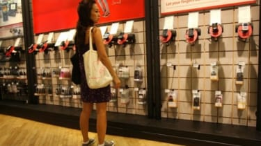 A woman shops at a Verizon store: Prepaid phones made up 29 percent of smartphone sales in 2011, up 5 percent from three years ago.