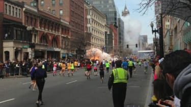 A photo posted on the 90.7 RAV FM Twitter feed shows one of the two reported explosions as it happens on April 15.