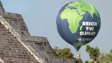 A balloon of the environmental group Greenpeace next to the Mayan ruins during the Rio+20 in Mexico: Climate-change deniers have poured millions of dollars into discrediting the work of clima