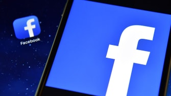The Facebook app logo is displayed on an iPad next to a picture of the Facebook logo on an iPhone on August 3, 2016 in London, England.