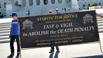 Advocates for abolishing the death penalty protest before Supreme Court