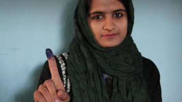 Facing violence and threats from the Taliban, Afghan voters still turn out