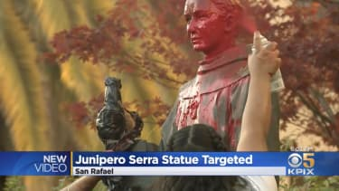 The vandalized statue.