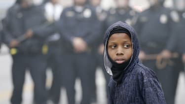 Police push back a protester in Baltimore.