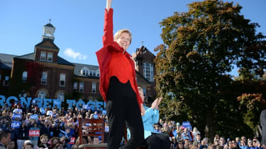 Elizabeth Warren waves to the crowd at a Hillary Clinton rally in 2016.