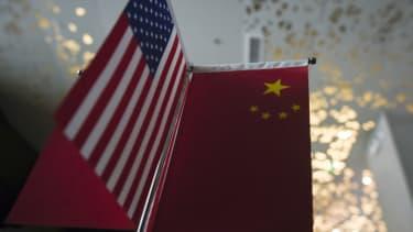 China, U.S. flags.