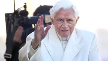 Pope Benedict XVI waves to the faithful as he arrives in St Peter's Square for his final general audience on Feb. 27, one day before he resigns.