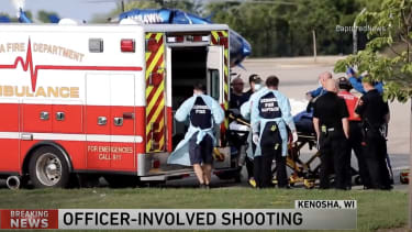 A shooting victim is put into an ambulance.
