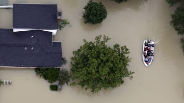 Houston residents evacuate their homes as floodwaters from Tropical Storm Harvey rise.