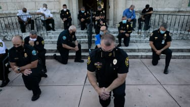 Kneeling police officers.