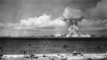A mushroom cloud blossoms over Bikini Atoll, Marshall Islands, in 1946.