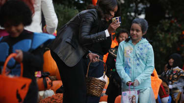 Anti-junk food campaigner Michelle Obama gave out Halloween candy
